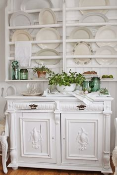 White painted furniture and plates evoke such a great feeling of homeliness
