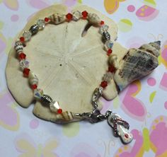 Flip-Flops & Shell Anklet Made with natural mini shells, Brilliance & Swarovski crystals & a large red/white flip-flop charm on stretch cord. $9.00 with charm, $8.00 without charm.
