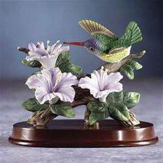 Hummingbirds on a wood base