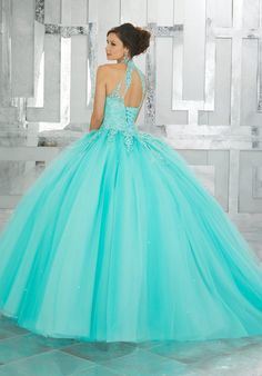 Beaded Lace Appliqués on a Tulle Ball Gown Classic and Feminine, this Quinceañera Ballgown Features a Lace Bodice Accented with Delicate Beading. A Full Tulle Skirt and Keyhole Corset Back Complete the Look. Mori Lee Quinceanera Dresses, Turquoise Quinceanera Dresses, Robes Quinceanera, Mori Lee Dresses, Prom Dresses, Tulle Ball Gown, Tulle Balls, Ball Gowns, Satin Tulle