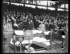 President Herbert Hoover tossing out the first ball to officially open the baseball season for the Washington Senators playing against the Philadelphia Athletics in the season's opener. Left to right: Secretary of Agriculture Arthur M. Hyde; Mrs. Herbert Hoover; President Hoover; Secretary of Treasury Andrew Mellon (sitting) Secretary of War James W. Good; Walter Johnson; and Clark Griffith. 4/17/1929. Library of Congress