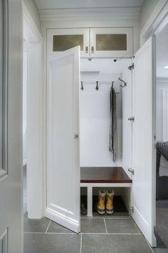 Concealed small hallway mudroom | Braams Custom Cabinets
