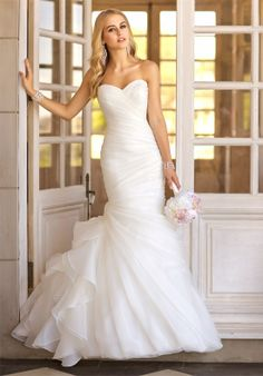 Trumpet designer wedding dress with asymmetrical organza pleats throughout bodice and skirt // Style #5835 from Stella New York