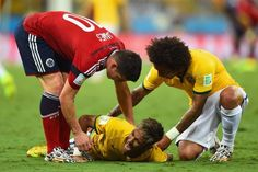Neymar of Brazil lies on the field after a challenge as teammate Marcelo and James Rodriguez of Colombia look on during the 2014 FIFA World Cup Brazil Quarter Final match between Brazil and Colombia at Castelao on July 2014 in Fortaleza, Brazil. Brazil World Cup, World Cup 2014, Fifa World Cup, Brazil Team, Neymar Brazil, James Rodriguez, Neymar Jr, Dentist Jokes