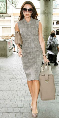 VICTORIA BECKHAM Of course her carryon matches! After debuting her new line of handbags at N.Y. Fashion Week, the designing star carries on the perfect taupe accessories to match her tweed sheath at Heathrow.