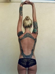 Don't mean to post a picture of a girls bum. But saw this on my feed and really like the back tattoo of the frame. Pretty cool idea.