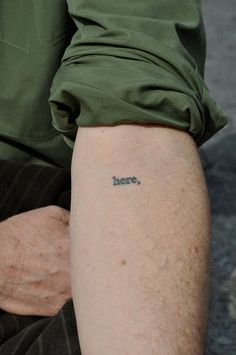 Rick Moody has one of the coolest tattoos possible (in our opinion), because it's part of Shelley Jackson's Skin project, a 2095-word story published exclusively in tattoos, one word each on as many willing volunteers, so it can never be read in its proper order, but just exists, pulsing, out in the world at all times. Photo via NY Press.