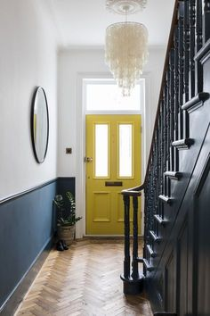 Interior Design by Imperfect Interiors at this Victorian Villa in London. A palette of contemporary Farrow & Ball paint colours mixed with traditional period details- Hague Blue spindles, staircase and white walls, a sunshine yellow front door, a large me Hallway Colours, House Design, House, Yellow Doors, Interior, Home, Victorian Hallway, Hallway Designs, Yellow Front Doors