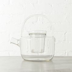 Shop betty glass teapot.   Asian inspiration steeps modern in ultra durable clear chem lab beaker glass.  Removable glass infuser does loose leaf herbal, oolong, rooibos.  Handcrafted spout and curved handle make it counter-worthy.