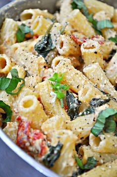 This vegan Tuscan Rigatoni is perfection! Garlicky spinach and sun dried tomatoe. - This vegan Tuscan Rigatoni is perfection! Garlicky spinach and sun dried tomatoes cooked in white wi - Vegan Foods, Vegan Dishes, Whole Food Recipes, Cooking Recipes, Cooking Tomatoes, Clean Eating, Healthy Eating, Vegetarian Recipes, Healthy Recipes