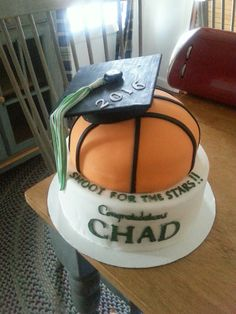 Basketball and cap graduation cake