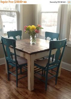 Love the turquoise chairs! Unique Primtiques Primitive Dark Walnut Stained & Country White painted & distressed FARMHOUSE Table SIZE: 42 x Small Kitchen Tables, Small Dining, Small Chairs, Kitchen Ideas, Blue Chairs, Small Square Dining Table, Round Dining, Colorful Chairs, Small Kitchens