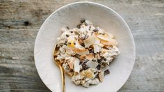 Muesli is a cold porridge of oats, fruit, and yogurt that softens overnight in the refrigerator. If you don't have time to prepare it the night before, don't worry. You can omit the oats and make a breakfast parfait with the orange (use one large orange), date, yogurt, cacao nibs, and coconut.