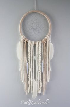 Unique 10 / 26.5 cm Eskimo Dreamcatcher entirely made by hand with pure natural materials, as such each product might vary slightly in size and colour.  Only good dreams would be allowed to filter through... Bad dreams would stay in the net, disappearing with the light of day.  The