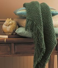 Wrap yourself in warmth; this knitted afghan is simple enough for beginners to make.