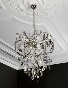 Delphinium by Brand Van Egmond - this is a special chandelier on sale for $4,500.00. The original price was $7,302.00. Hand forged metal from The Netherlands.  www.illuminc.com