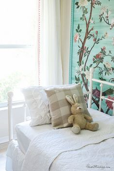 Green garden mural with flowers and birds in little girl's room- white vintage looking iron simple daybed