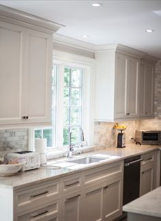 John Johnstone Kitchen and Bath - kitchens - ceiling height upper cabinets, contemporary nickel hardware, white quartz counters, chrome gooseneck faucet, mini gray and white marble brick tile, shaker cabinets, inset white cabinets, stainless steel dishwasher, under cabinet lighting, cabinet crown molding