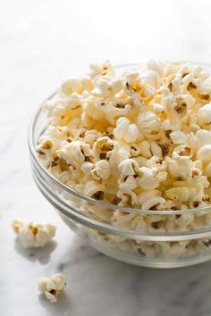 Learn how to make PERFECT popcorn on the stovetop. No burnt kernels! Easy stove-top popcorn recipe on SimplyRecipes.com #popcorn #snack #healthy #healthysnack