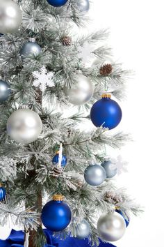 I've always wanted to spray a Christmas tree all white with snow and then decorate it with silver and blue. It's just sooooo pretty.