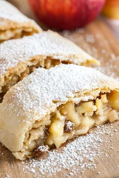 Apple Strudel is much easier to make from scratch than you think and tastes amazing dusted with powdered sugar! Everyone will love this traditional Apfelstrudel that has a flaky crust and is filled with juicy spiced apples. Austrian Desserts, German Desserts, Austrian Recipes, Austrian Cuisine, German Recipes, Apple Strudel Recipe From Scratch, German Apple Strudel Recipe, Authentic Apple Strudel Recipe, Traditional Apple Strudel Recipe