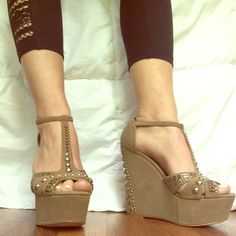 Eva & Zoe Jeweled Wedges Only worn a few times! Super comfortable and can match almost any outfit! All studs and jewels are 100% intact! Material is suede like (all man made materials). Size 5.5 but the fit more like a 6! Eva & Zoe Shoes Wedges