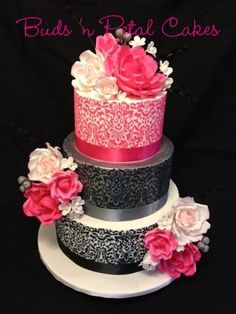 3 tier wedding cake with stencilling, silver shimmer on middle tier and gum paste roses.