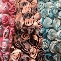 """DELICATE Fabric, Baby Rosebud Mesh Bouquet fabric $13.00 a yard. Other fabrics on this site include but are not limited to faux fur, minky, spandex of many varieties, sequined fabric, and lace. They also have """"grab bags"""" of left over fabrics for lace, fur, sequined, or silk fabrics. Worth a second, third, hundredth look!"""