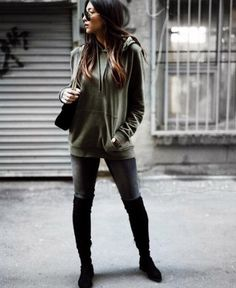 A hooded sweater with skinny jeans and over-the-knee boots.