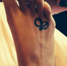 Anchor infinity sign foot tattoo