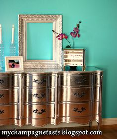 silver leaf french provincial...Why do I like this? Oh yeah....because it's shiny! THAT wall color...not so much!