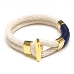 The simple design of the t-bar bracelet makes it easy to throw on and go, or pair it with a few other pieces. -Natural ivory cotton rope -Gold plated t-bar clasp closure -Gold plated spacer bead -Hand