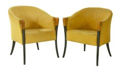 A pair of tub chairs,  1950s, upholstered in yellow fabric, with ebonised and cherrywood turned supports Sold for £200 on 27th January 2015