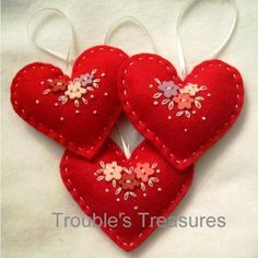 Loving hearts from Troublet Sweet felt heart ornaments with buttons and a touch of embroidery--by Tr Embroidery Hearts, Felt Embroidery, Felt Applique, Hungarian Embroidery, Embroidery Jewelry, Embroidery Hoops, Embroidery Patterns, Felt Christmas Decorations, Felt Christmas Ornaments