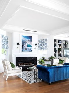 Hamptons-inspired living room with blue accents. Hamptons Style Homes, The Hamptons, Custom Cushions, Arched Windows, French Oak, Waterfront Homes, Step Inside, Blue Accents