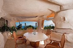 Fantastic Flintstones Style Malibu Retreat Home Design With Stone Room Decoration Used Wooden Furniture In Dining Room Interior Style Cool Stuff, Funny Stuff, Unique Homes For Sale, Unusual Homes, Flintstone House, Fred Flintstone, Malibu Homes, Malibu Mansion, Retreat House