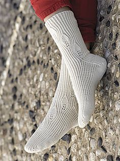 Leaf lace ribbed socks knit toe up using Cat's new architecture.