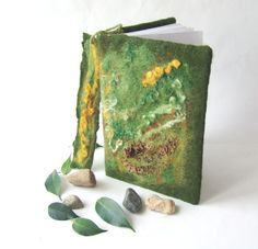 This journal cover is handmade with the wet felt technology and used 100% wool and cotton fabric, silk fibers , silk fabric, yarn, wool locks..The notebook is measures 20 cm x 15 cm x 2 cm. It is included in purchase. Bookmark included too.   The cover will fit any notebook with those dimensions. These can be used as a notebook or diary.    You can order a new cover for your notebook. Please write the size and pattern, and color
