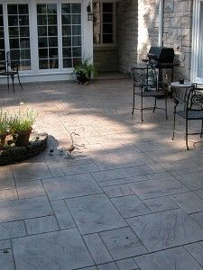 Over-poured concrete. A thin layer of textured and colored concrete poured over an existing concrete slab.