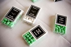 I've never seen this before...tic tacs and a sticker to match your wedding decor :)