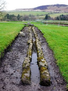 The aqueduct probably supplied water for the Roman military bath house which stood amongst the buildings of the civilian settlement (vicus) at the north-west corner of Vindolanda Roman Fort. It was built for the Fourth Cohort of Gauls around AD213.