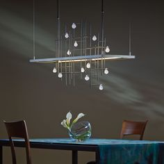 """Hubbardton Forge's Spring pendant light from the Four Seasons Collection. Beautiful linear forms, with """"raindrops"""" on a trellis."""