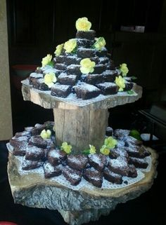 Brownies displayed on tiered tree trunks for an Engagement Party