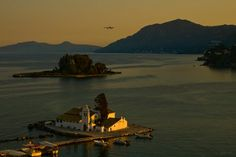 Landing on sunset. Corfu by geotsak Corfu Island, Northern Lights, Boat, Community, Italy, Sunset, Night, World, Building