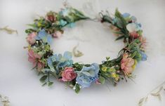 Floral Hair Wreath with greenery leaves and light blue and pink wildflowers can be one of the most important details of your Boho Woodland Wedding. This Flower Crown will be a great elegant detail of your Maternity photo shoot too. Materials: textile flowers + back tie ribbon Size: Pink Floral Crowns, Pink And Blue Flowers, Floral Hair, Flower Crown Wedding, Wedding Headband, Wedding Flowers, Wedding Crowns, Flower Crowns, Pink Photo