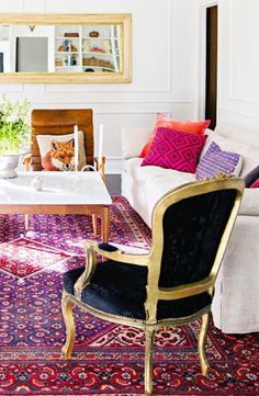 Digging this colorful rug mixed with black velvet & David Hicks' La Fiorentina fabric! Get yours here: http://www.decoratorsbest.com/p-groundworks-2430-gwf-la-fiorentina-wine-ma-fabric-9675.aspx