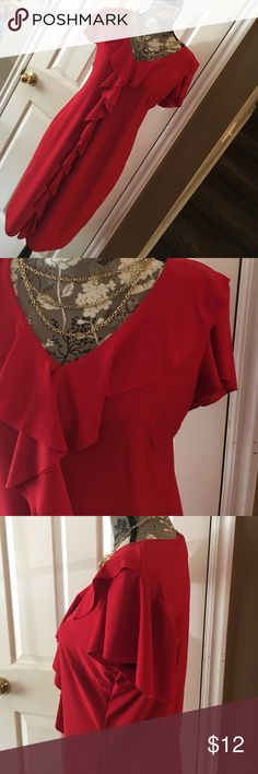 Silky red dress Comfortable little red dress. Knee length. V neck that descends into a delicate Ruffle down the front of dress.  Flowing capped sleeve. Size medium. Avon Dresses Midi