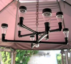 Items similar to Outdoor lighting, solar chandelier. Contemporary solar outdoor chandelier for backyard, patio, gazebo, garden or deck. on Etsy Solar Chandelier, Outdoor Chandelier, Outdoor Lighting, Lighting Ideas, Accent Lighting, Pvc Pipe Crafts, Pvc Pipe Projects, Welding Projects, Outdoor Projects