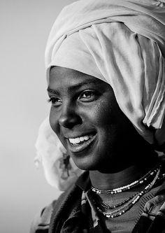 Black And White Portrait Of An Oromo Woman With Toothy Smile, Dire Dawa, Ethiopia