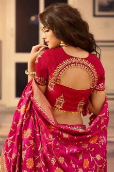 blouse designs Make a Luxurious statement with this gorgeous Golden and Ruby Red Silk Lehenga Choli. The Lehenga Set is beautifully weaved together with Stonework and Heavy Embroidery. Indian Blouse Designs, Choli Blouse Design, Wedding Saree Blouse Designs, Saree Blouse Neck Designs, Sari Design, Fancy Blouse Designs, Wedding Sarees, Latest Blouse Designs, Golden Blouse Designs